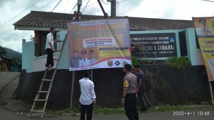Polsek Cidahu Pasang Baliho Himbauan Penutupan Sementara Destinasi Wisata